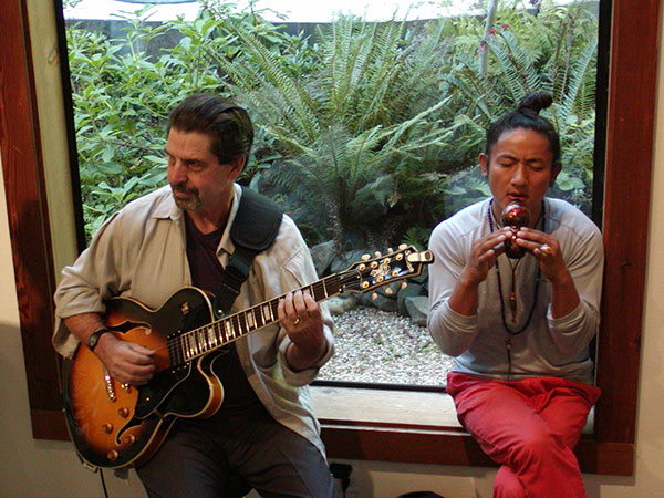 Chris Doering (left) and Love Sutra Lama (right) entertain at the Gualala Salon opening reception