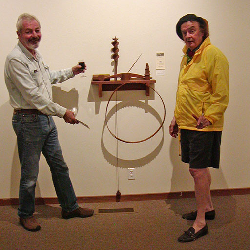 Gualala Salon first place winner Allan Adams (left) and judge Ira Yeager (right) with Adams' winning piece, 'Mendonoma Memorabilia'