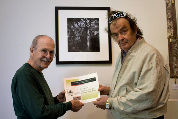 Gualala Salon des Refusés artist Peter Dobbins (left) receives his People's Choice Second Place award from Gualala Salon judge Ira Yeager (right)