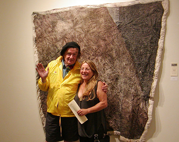 Gualala Salon second place winner Suzan Friedland (right) and judge Ira Yeager (left) with Friedland's winning piece 'Inflaton Field'
