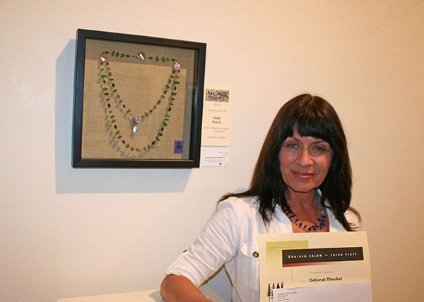 Gualala Salon third place winner Deborah Threlkel with her winning piece 'Abalone Queen Necklace'